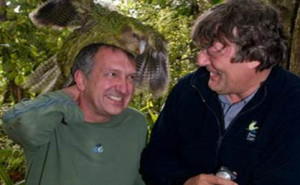 Naturalist Mark Carwardine (with a kākāpō on his head) and Stephen Fry in the BBC TV series, Last Chance to See. The series explored the efforts to save some of the world's most rare and critically endangered animals. How much 'weight' should be given to saving a species based on its uniqueness or phylogenetic difference?