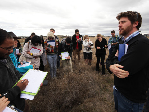 James Trezise out in the field. This field, however, is part a paddock providing habitat for the threatened legless lizard - and it's up for proposed development. James (on the right) is explaining to a group of biodiversity-conservation students from the Australian National University how the EPBC Offsets mechanism deals with this type of proposal