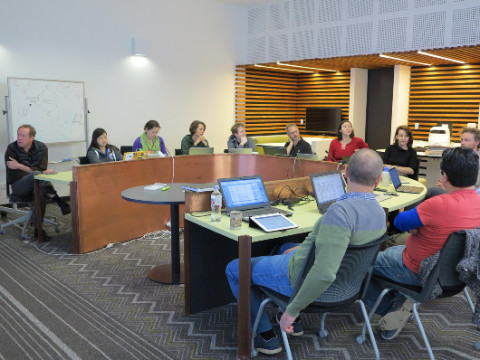 Workshoppers discuss the finer points of causal inference at the CEED workshop at the University of Queensland in July. (Photo by Jane Campbell)