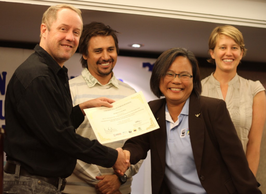 Robecca Jumin from WWF-Malaysia (third from the right) receives a certificate in conservation planning from trainers from the University of Queensland (during one of the Marxan courses run in Malaysia). From the right are Hugh Possingham, Hedley Grantham and Carissa Klein. The course was run in 2010 in Sabah.