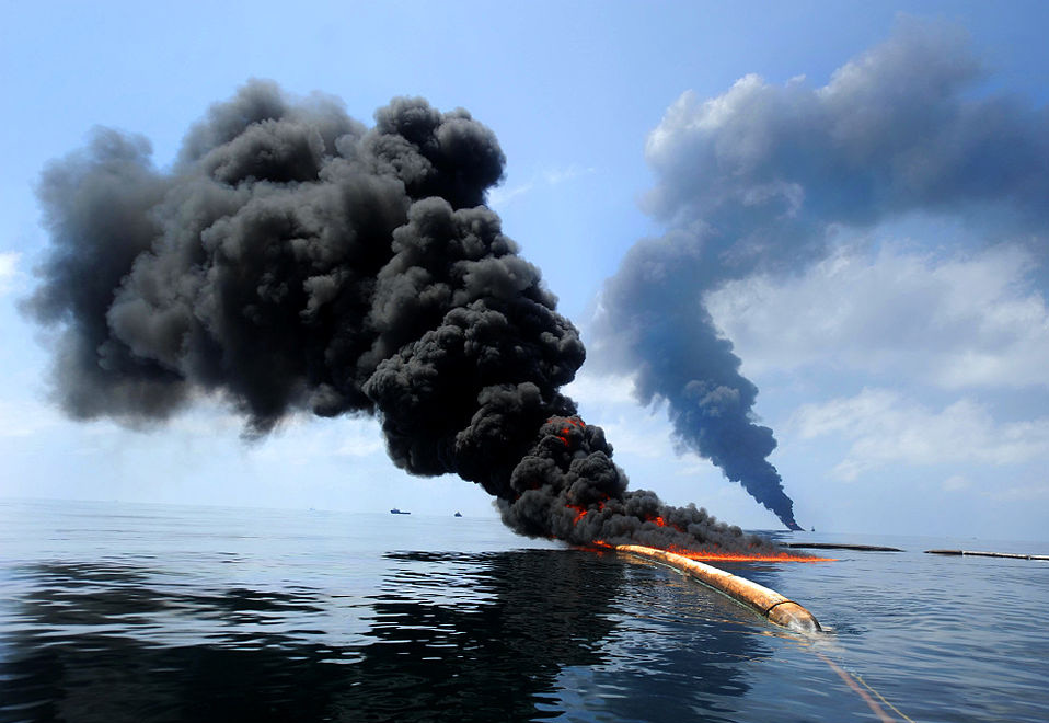 Dark clouds of smoke and fire emerge as oil burns during a controlled fire in the Gulf of Mexico in May 2010 following the Deepwater Horizon disaster. (Image: Justin Stumberg)
