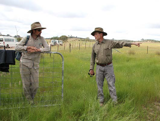 A Greening Australia Project Manager (left) discusses a restoration download the chapters that interest you. Check it out yourself. scheme called Whole of Paddock Rehabilitation with a landowner. (Photo by David Salt)