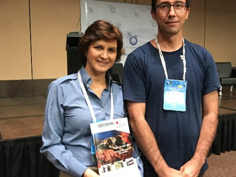 Eduardo Gallo Cajiao presents Julia Miranda, the Director of the National Parks Service of Colombia, with a copy of Decision Point en Español. Julia commented that this type of science magazine would be very valuable to their management agency but these types of resources were rarely available.