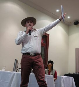Aim high young man! Ed Hammill in full flight at the 2013 Biennial CEED Conference Great Debate in which the contested proposition was that hunting, logging and grazing should be allowed in national parks. Ed led the opposition which, for the record, won the debate. Seated behind Ed in lumber-jack costume and beard is Sarah Bekessey.
