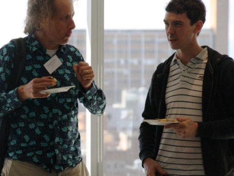 Problem solving over coffee* and cake. Mick McCarthy (left) and Chris Baker ponder a mathematical conundrum during MOBSYM.